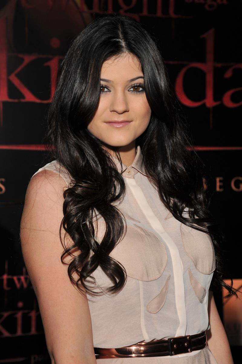 Wearing her long, dark brunette hair in tousled curls with a subtle smokey eye, Jenner attends the The Twilight Saga: Breaking Dawn Part 1 in 2011.