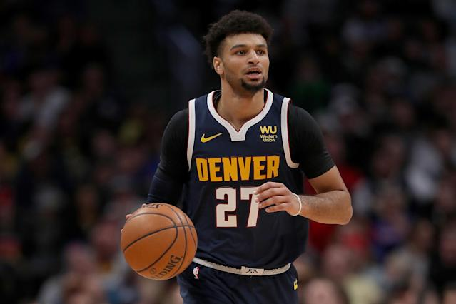 """The <a class=""""link rapid-noclick-resp"""" href=""""/nba/teams/denver/"""" data-ylk=""""slk:Nuggets"""">Nuggets</a> expect <a class=""""link rapid-noclick-resp"""" href=""""/nba/players/5638/"""" data-ylk=""""slk:Jamal Murray"""">Jamal Murray</a> to be sidelined for the """"foreseeable future"""" after going down with an ankle injury on Wednesday. (Matthew Stockman/Getty Images)"""