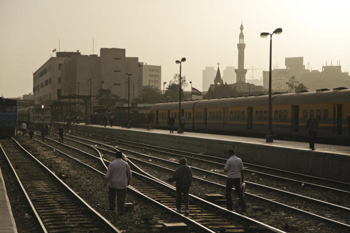 Egyptian men rush to catch a train after hours of waiting due to a train drivers strike at the main train station in Cairo, Egypt, Monday, April 8, 2013. A union of Egypt's train drivers and conductors announced on Sunday April 7, 2013 that they have gone on strike, the latest in a seemingly endless series of work stoppages to hit the country in the past two years. The strike began, hours after authorities approved a 10 percent hike in the allowance routinely given to train drivers and conductors. The raise was rejected as too little. (AP Photo/Nariman El-Mofty)