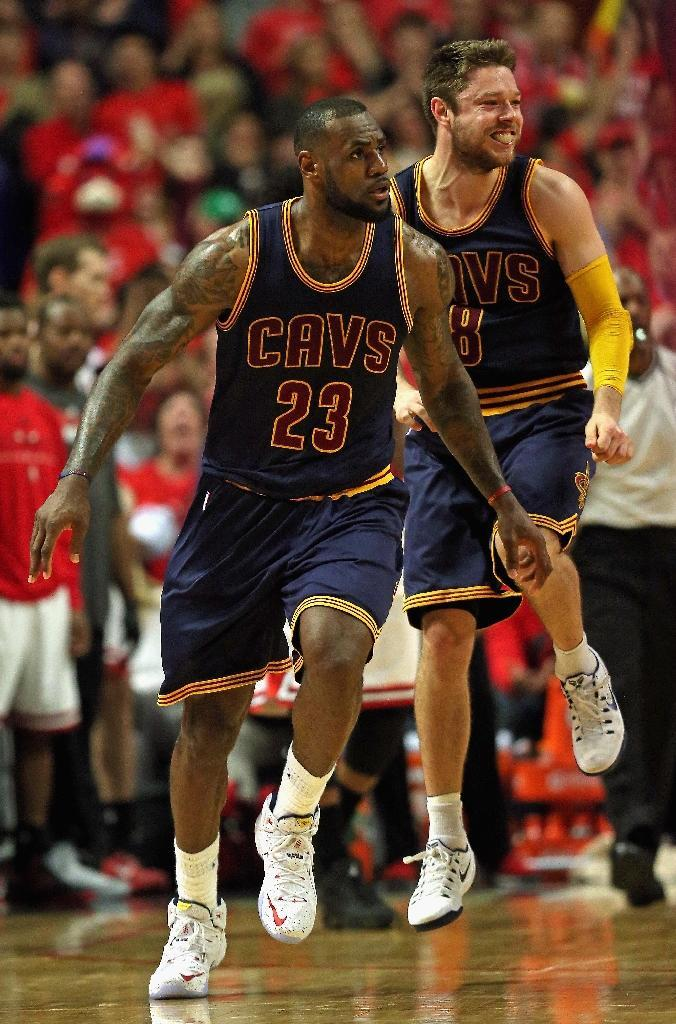 LeBron James (L) and Matthew Dellavedova of the Cleveland Cavaliers celebrate a win over the Chicago Bulls in Game Four of the Eastern Conference Semifinals of the 2015 NBA Playoffs on May 10, 2015 in Chicago (AFP Photo/Jonathan Daniel)