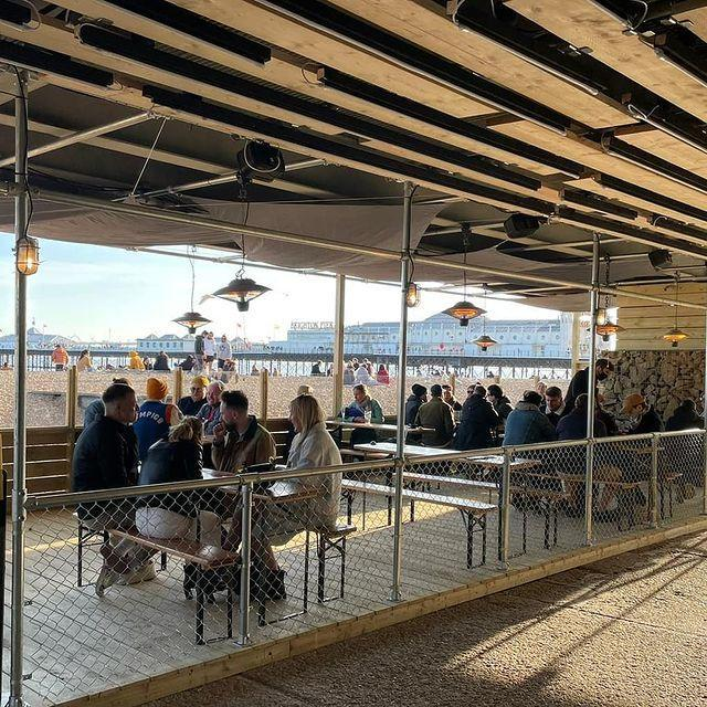 """<p>Brighton's promenade is famous for its buzzing nightlife and dreamy views of the English Channel - meaning it's definitely one of our favourite places for a seaside drink.</p><p>Check out the newly opened Electric Arcade, which has a beachfront terrace by the pier, as well as old favourites like the Fortune of War pub, a place that's been going strong for nearly 150 years.</p><p>There's also the ever-popular OhSo Social, which transforms from family-friendly café by day into a vibrant cocktail bar at night.</p><p><a href=""""https://www.instagram.com/p/COFYGUaHKXz/"""" rel=""""nofollow noopener"""" target=""""_blank"""" data-ylk=""""slk:See the original post on Instagram"""" class=""""link rapid-noclick-resp"""">See the original post on Instagram</a></p>"""