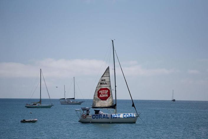 """A boat launches a sail in protest to the Adani Carmichael Coal Mine proposal in Airlie Beach, Australia on April 26, 2019.<span class=""""copyright"""">Lisa Maree Williams—Getty Images</span>"""