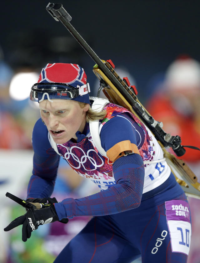 Norway's Tora Berger approaches the shooting range during the women's biathlon 10k pursuit, at the 2014 Winter Olympics, Tuesday, Feb. 11, 2014, in Krasnaya Polyana, Russia. (AP Photo/Lee Jin-man)