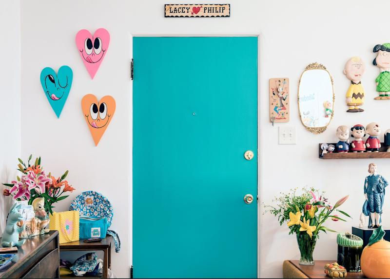 The turquoise door perfectly matches one of the heart cutouts (also by Chris Uphues) hanging next to it.