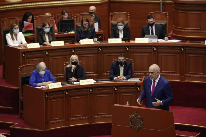Albanian Prime Minister Edi Rama speaks during a debate at the parliament in Tirana, Albania, Thursday, Sept. 16, 2021. Albania's parliament was to vote late Thursday to approve the new, female-dominated Cabinet of Prime Minister Edi Rama, with 12 of the 17 jobs going to women, propelling Albania to the top of global rankings in terms of the percentage of women holding Cabinet positions. (AP Photo/Franc Zhurda)