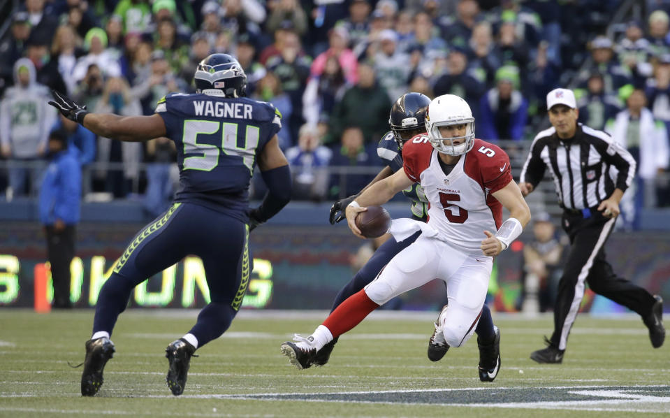 Arizona Cardinals quarterback Drew Stanton (5) scrambles under pressure from Seattle Seahawks middle linebacker Bobby Wagner (54) in the second half of an NFL football game, Sunday, Nov. 23, 2014, in Seattle. The Seahawks won 19-3. (AP Photo/Elaine Thompson)