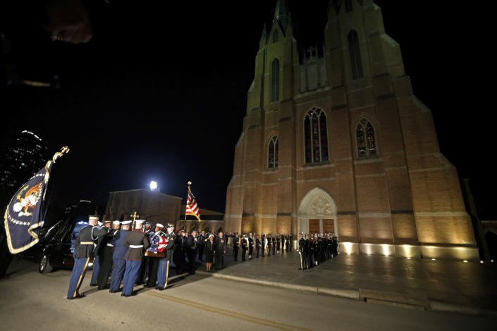The flag-draped casket of former President George H.W. Bush is carried by a joint services military honor guard at St. Martin's Episcopal Church Wednesday, Dec. 5, 2018, in Houston. (Photo: Gerald Herbert/AP)