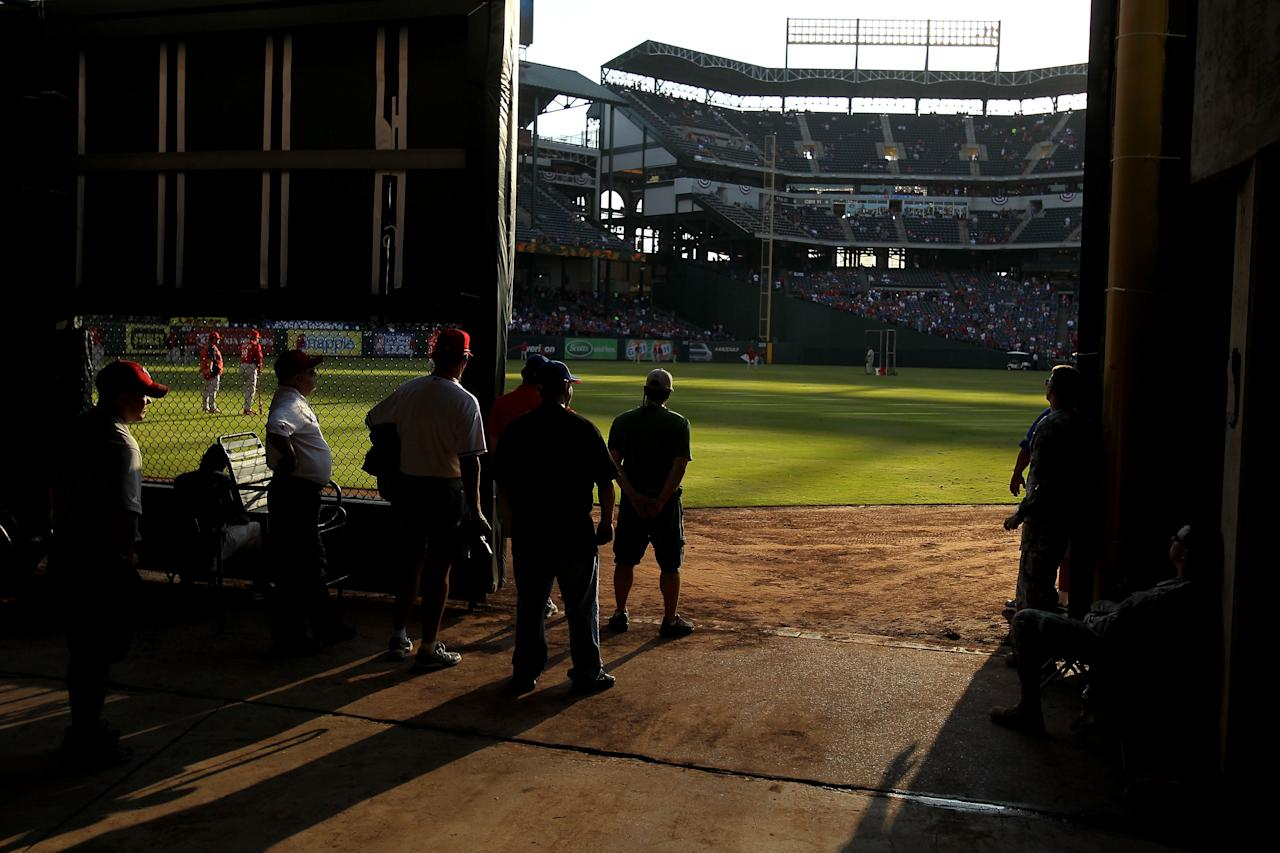ARLINGTON, TX - OCTOBER 23: People look out onto the field during batting practice prior to Game Four of the MLB World Series between the St. Louis Cardinals and the Texas Rangers at Rangers Ballpark in Arlington on October 23, 2011 in Arlington, Texas.  (Photo by Ezra Shaw/Getty Images)