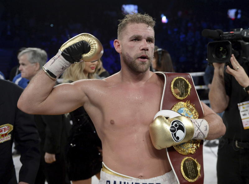 "FILE - In this Dec. 16, 2017, file photo, Billy Joe Saunders, of Britain, celebrates his win over David Lemieux, of Canada, to retain the WBO middleweight boxing title in Laval, Quebec. Saunders had his boxing license suspended Monday, March 30, 2020, after publishing a social media video in which he appeared to condone domestic violence amid the coronavirus outbreak. He has apologized for his remarks, saying: ""It was a silly mistake but I didn't mean to cause any harm to anyone and I certainly wouldn't promote domestic violence.""(Ryan Remiorz/The Canadian Press via AP)"