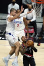 Portland Trail Blazers guard Damian Lillard (0) drives to basket as Los Angeles Clippers center Ivica Zubac, left, defends during the first half of an NBA basketball game Tuesday, April 6, 2021, in Los Angeles. (AP Photo/Marcio Jose Sanchez)