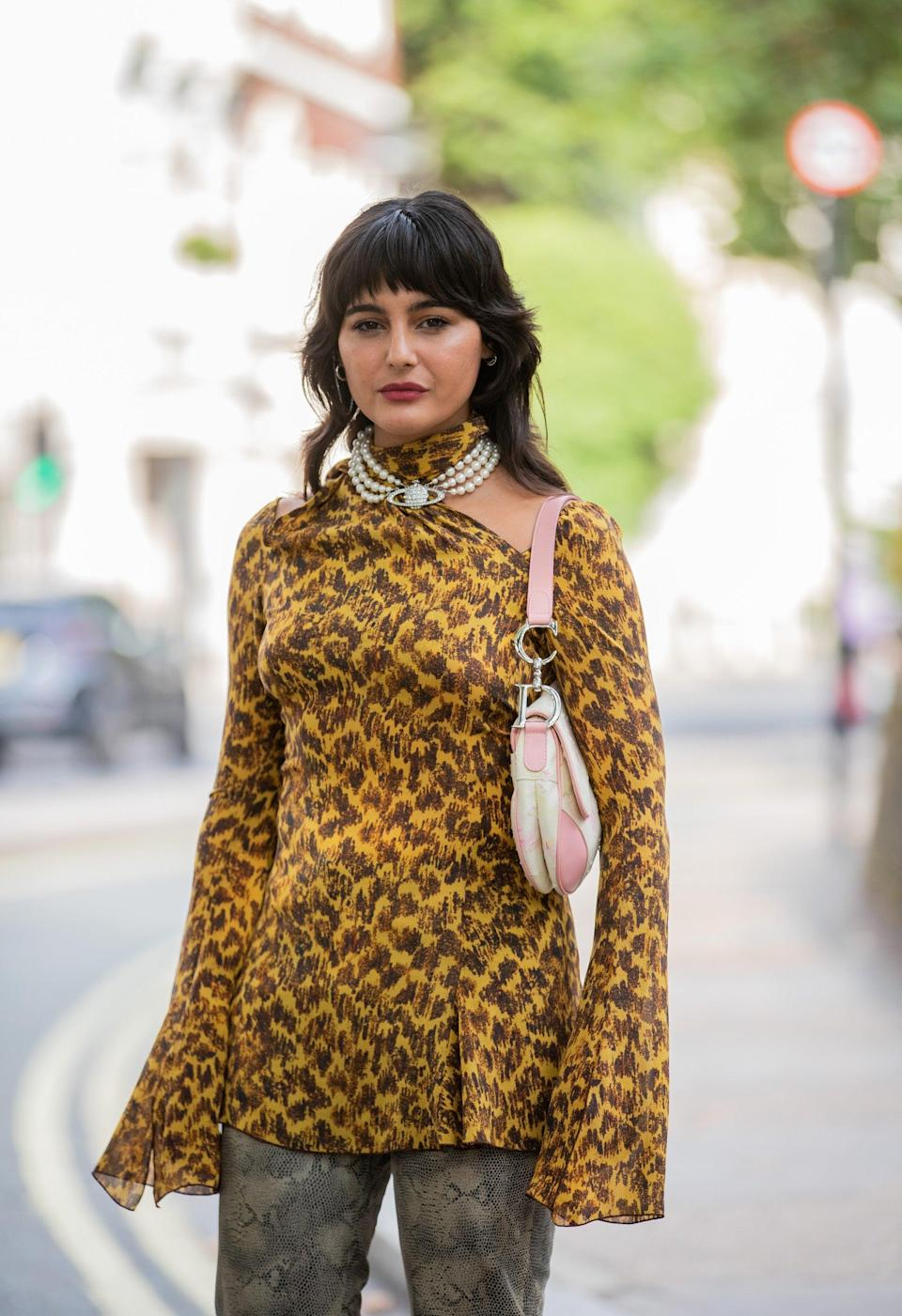 """Stylist and fashion brand owner María Bernad also embraces mismatched patterns beautifully. We love the chunky Vivienne Westwood necklace, too. <span class=""""copyright"""">Photo Courtesy of Christian Vierig/Getty Images.</span>"""
