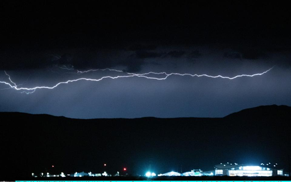 Lightning flashes over Spaceport America prior to the launch of Virgin Galactics SpaceShipTwo Unity in Truth Or Consequences, New Mexico. - David Lienemann/Getty Images