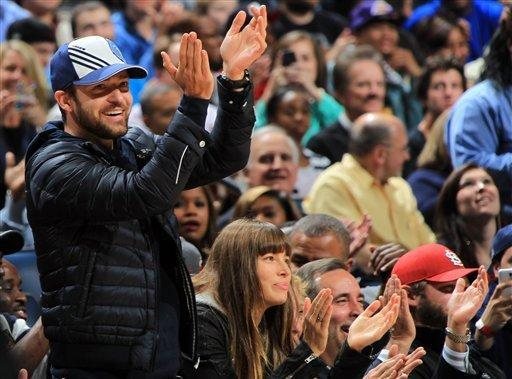 Justin Timberlake, who is a member of Memphis Grizzlies minority ownership group, cheers on the Memphis Grizzlies with wife Jessica Biel at his side, Friday, Nov. 23, 2012, during an NBA basketball game between the Grizzlies and the Los Angeles Lakers at the FedExForum in Memphis, Tenn. (AP Photo/The Commercial Appeal, Nikki Boertman)