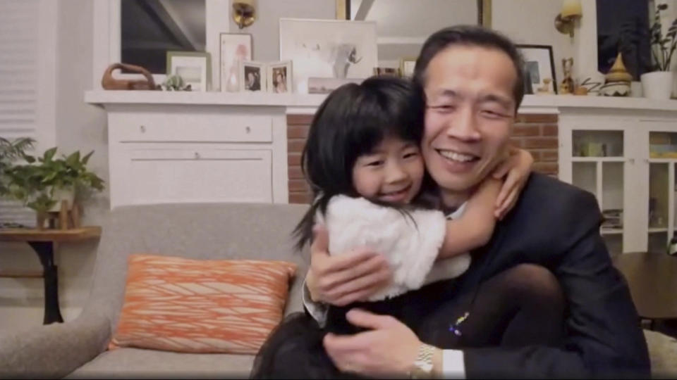 """In this video grab issued Sunday, Feb. 28, 2021, by NBC, director Lee Isaac Chung is hugged by his daughter as he accepts the award for best foreign language motion picture for """"Minari"""" from the United States at the Golden Globe Awards. (NBC via AP)"""