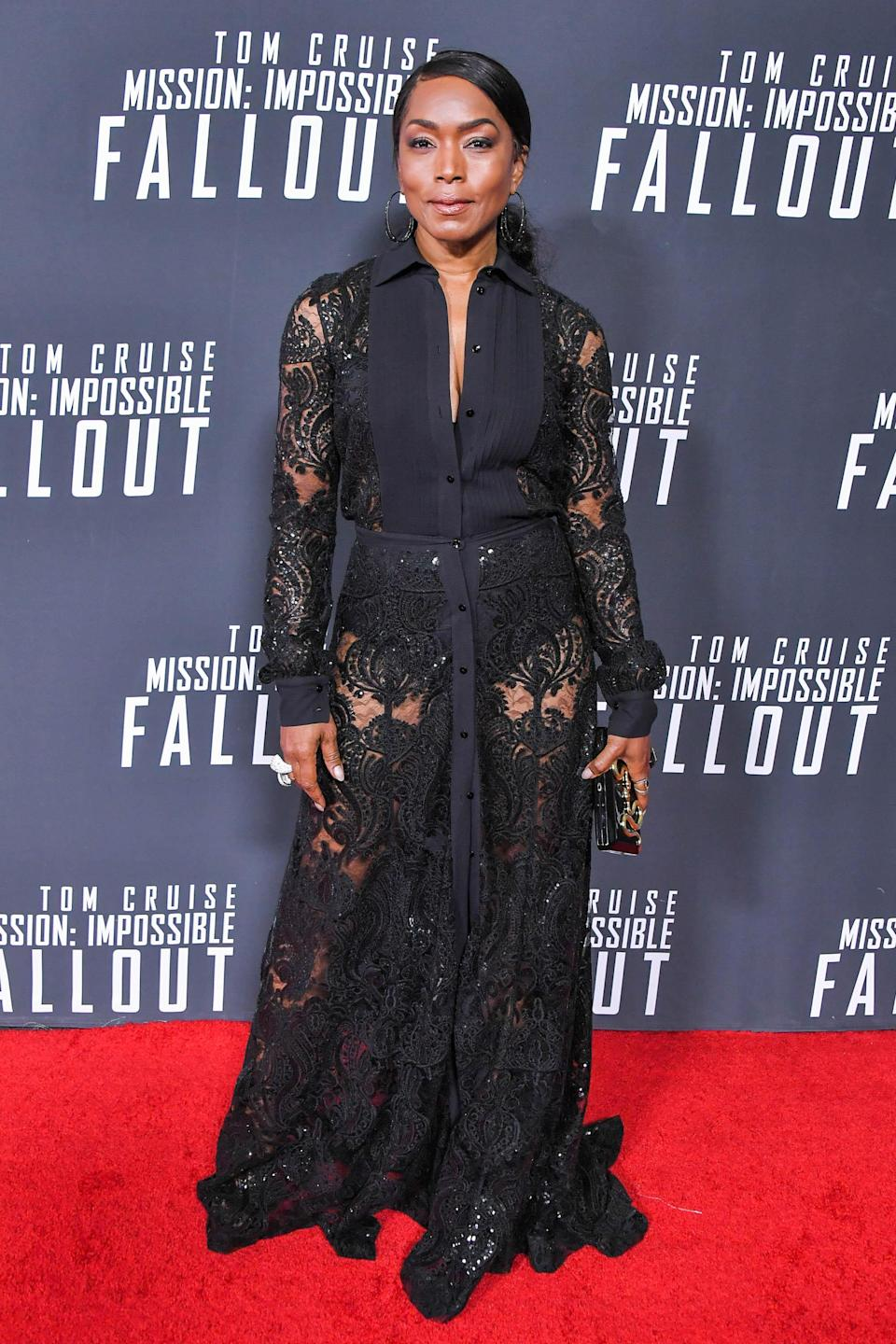 <p>Bassett picked out a black, lace look by Mario Dice for the premiere. <em>[Photo: Getty]</em> </p>
