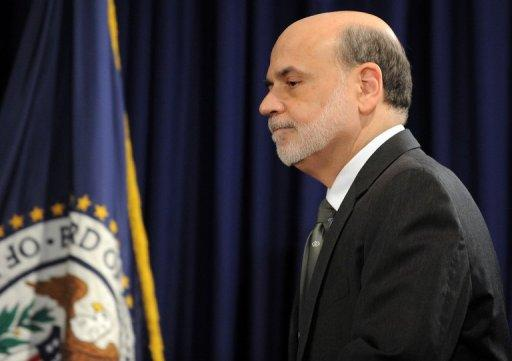 US Federal Reserve chief Ben Bernanke arrives for a news conference in Washington, DC, on September 13. The US Federal Reserve took aim at slow growth and high joblessness, announcing a new, open-ended $40 billion per month bond-buying program as it slashed its 2012 growth forecast