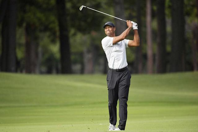 Tiger Woods shoots on the 9th hole during the second round of the Zozo Championship, a PGA Tour event, at Narashino Country Club in Inzai, Japan