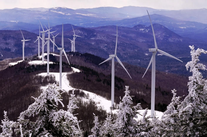 Wind turbines face into the breeze on top of Saddleback Wind Mountain, Saturday, Feb. 6, 2021, in Carthage, Maine. President Joe Biden wants to change the way the U.S. uses energy by expanding renewables, but faces several challenges. (AP Photo/Robert F. Bukaty)