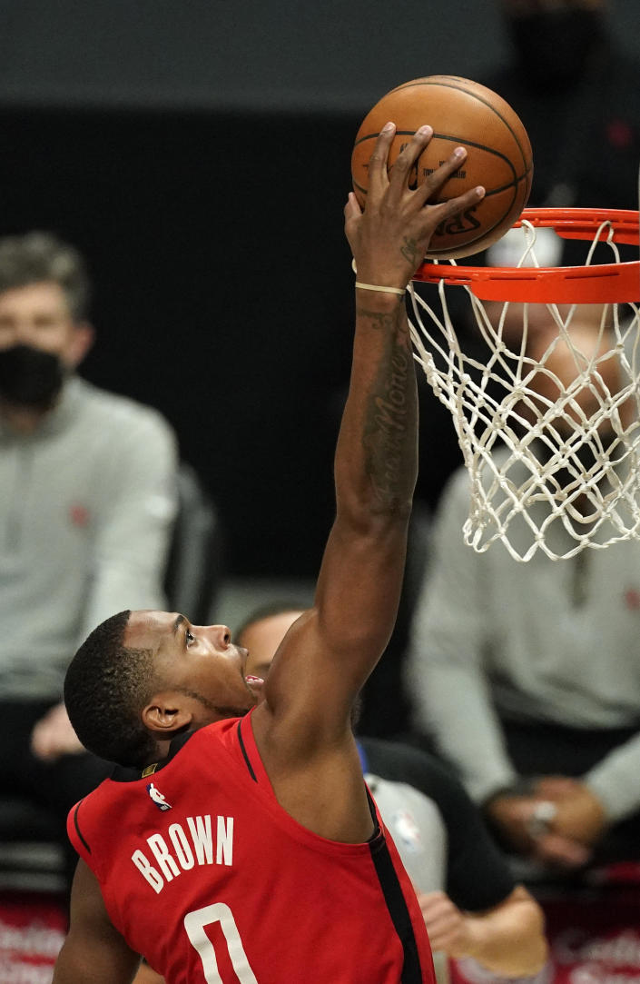 Houston Rockets forward Sterling Brown dunks during the first half of an NBA basketball game against the Los Angeles Clippers Friday, April 9, 2021, in Los Angeles. (AP Photo/Mark J. Terrill)