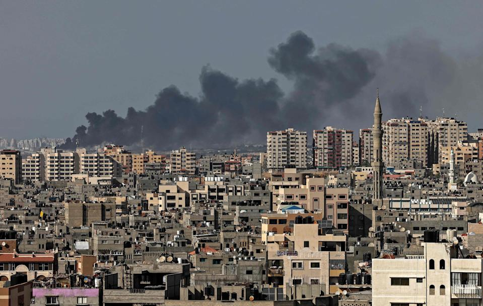 <p>Smoke billows from an Israeli air strike in Gaza city controlled by the Palestinian Hamas movement, on May 11, 2021.</p> ( (Photo by MAHMUD HAMS/AFP via Getty Images))