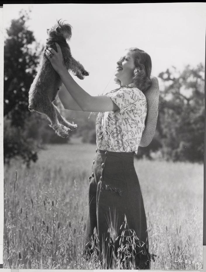 The TV icon is photographed with her pet dog.