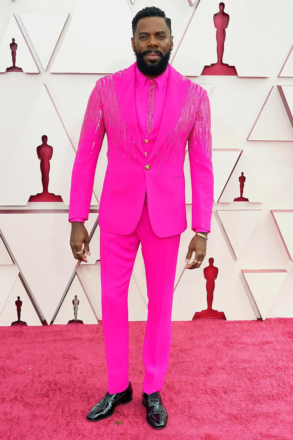 "<p>In one of the hottest shades of the moment (the dominance of which <a href=""https://ew.com/oscars/oscars-pink-red-fashion/"" rel=""nofollow noopener"" target=""_blank"" data-ylk=""slk:began at last year's Oscars"" class=""link rapid-noclick-resp"">began at last year's Oscars</a>), the <i>Ma Rainey's Black Bottom </i>star — also styled by Wayman and Micah — dazzled in a bold fuchsia three-piece suit from Atelier Versace, embroidered with Swarovski crystals.</p>"