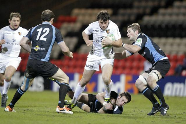 Glasgow Warriors' Ruaridh Jackson (Lower), Graeme Morrison (2L) and John Barclay (R) tackle Toulouse's Yannick Jauzion (3R) during a Heineken Cup, pool six, rugby union match at Firhill Stadium, Glasgow, Scotland, on December 10, 2010. AFP PHOTO/GRAHAM STUART (Photo credit should read GRAHAM STUART/AFP/Getty Images)