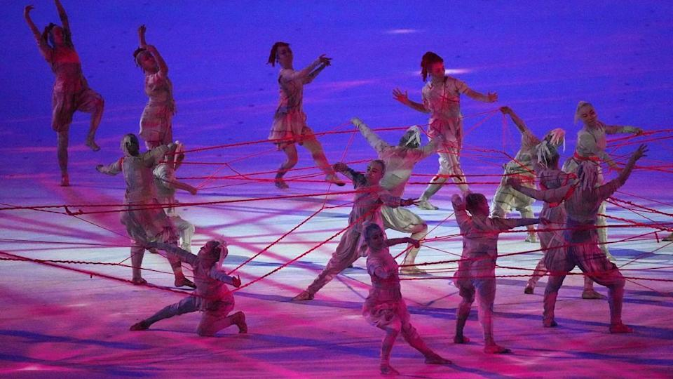 """<div class=""""paragraphs""""><p>Dancers perform during the opening ceremony on Friday</p></div>"""