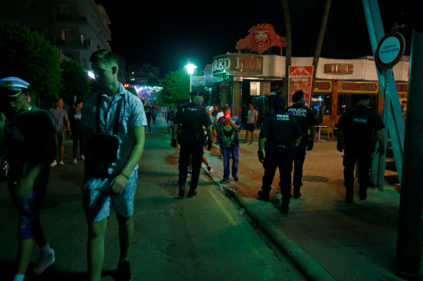 Police patrol the streets of Magaluf following the incident. (Reuters)