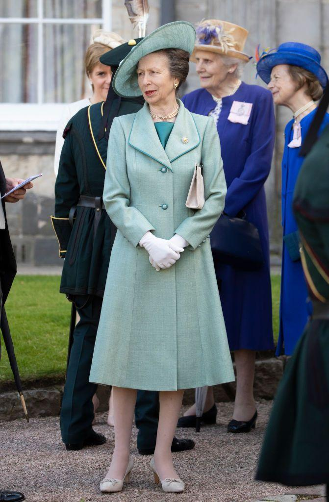 <p>Princess Anne attended a garden party at The Palace Of Holyroodhouse in 2019 in different tones of the same shade of chic teal. </p>