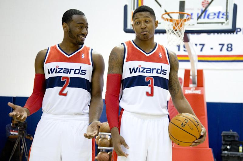 Washington Wizards' John Wall, left, and Bradley Beal poses for a photographer during NBA basketball media day at the Verizon Center in Washington, Friday, Sept. 27, 2013. (AP Photo/Carolyn Kaster)