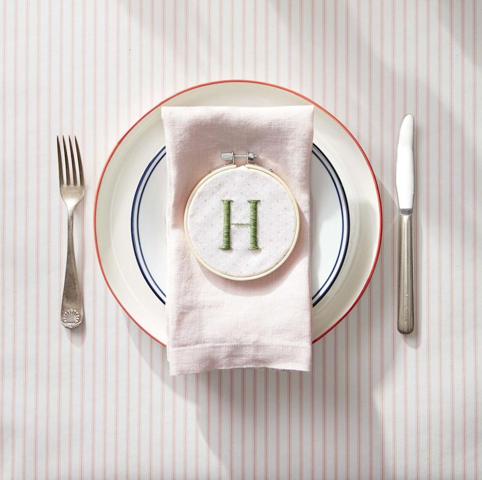 """<p>Sit mom at the head of the table and celebrate her with an embroidery hoop stitched with her initial.<br><strong><br>To make</strong>: Place a piece of fabric in an embroidery hoop and embroider desired letter. Adjust fabric if necessary, to make sure letter is in the center of the hoop. Cut off excess fabric, leaving a one-inch overhang. Tack overhang to the inside of the hoop using hot-glue.</p><p><a class=""""link rapid-noclick-resp"""" href=""""https://www.amazon.com/Pllieay-Pieces-Embroidery-Christmas-Decoration/dp/B07YKXXXVV/ref=sr_1_1_sspa?tag=syn-yahoo-20&ascsubtag=%5Bartid%7C10050.g.2357%5Bsrc%7Cyahoo-us"""" rel=""""nofollow noopener"""" target=""""_blank"""" data-ylk=""""slk:SHOP EMBROIDERY HOOPS"""">SHOP EMBROIDERY HOOPS</a></p>"""