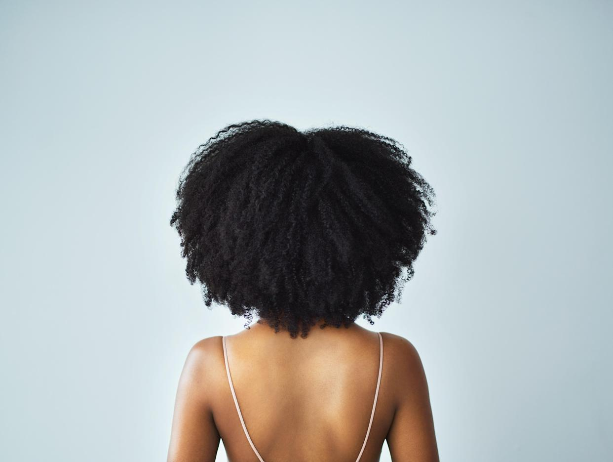 Black girls in Wales would be forced to travel for miles and miles to buy the haircare products they needed because the products available on the high street weren't for their hair type. (Stock photo/Getty Images)