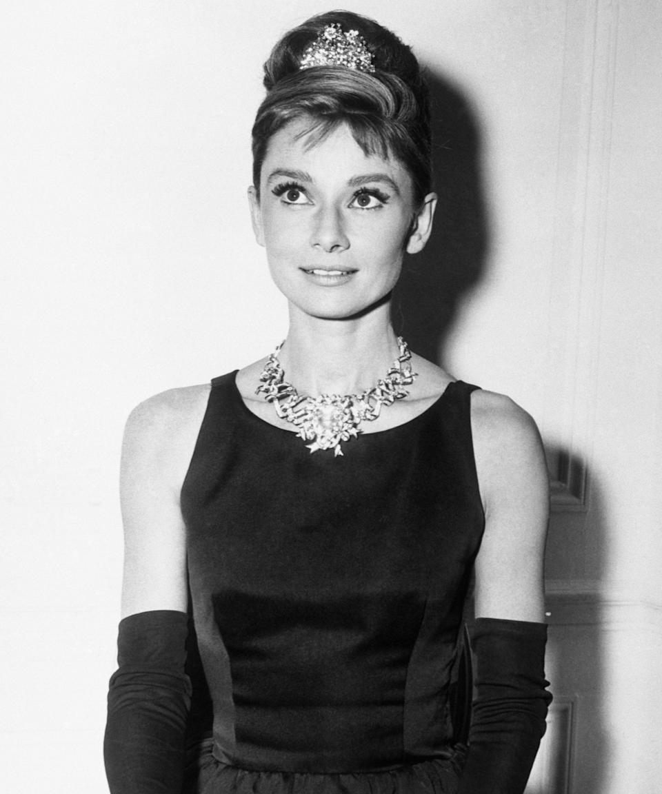 "<h3>Audrey Hepburn<br></h3><br>With a high ballerina bun and a teeny tiara, you can easily recreate this <em><a href=""https://www.refinery29.com/en-us/2017/11/180248/tiffany-co-blue-box-cafe"" rel=""nofollow noopener"" target=""_blank"" data-ylk=""slk:Breakfast at Tiffany's"" class=""link rapid-noclick-resp"">Breakfast at Tiffany's</a></em> look. Bonus points if you already have <a href=""https://www.refinery29.com/en-us/2018/03/193148/baby-bangs-hair-trend"" rel=""nofollow noopener"" target=""_blank"" data-ylk=""slk:wispy baby bangs"" class=""link rapid-noclick-resp"">wispy baby bangs</a>.<span class=""copyright"">Photo: Bettmann/Getty Images.</span>"