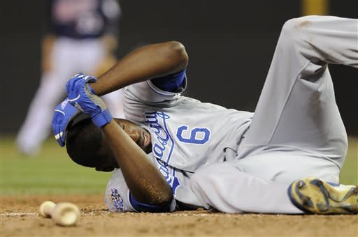 Kansas City Royals' Lorenzo Cain falls to the ground after getting hit in the helmet by a pitch from Minnesota Twins' Luis Perdomo in the eighth inning of a baseball game, Tuesday, Sept. 11, 2012, in Minneapolis. (AP Photo/Jim Mone)