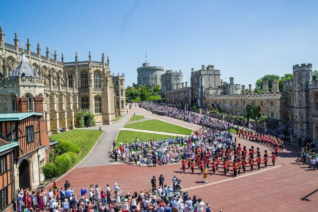 Crowds gathered in front of Windsor Castle to watch the royal wedding on May 19, 2018.