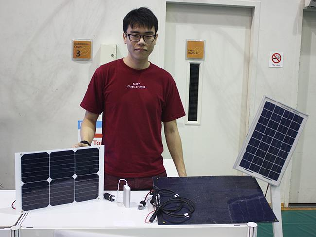 Tan Yi Hao with his brainchild, a portable solar kit that can charge a portable charger and other devices that run on USB.