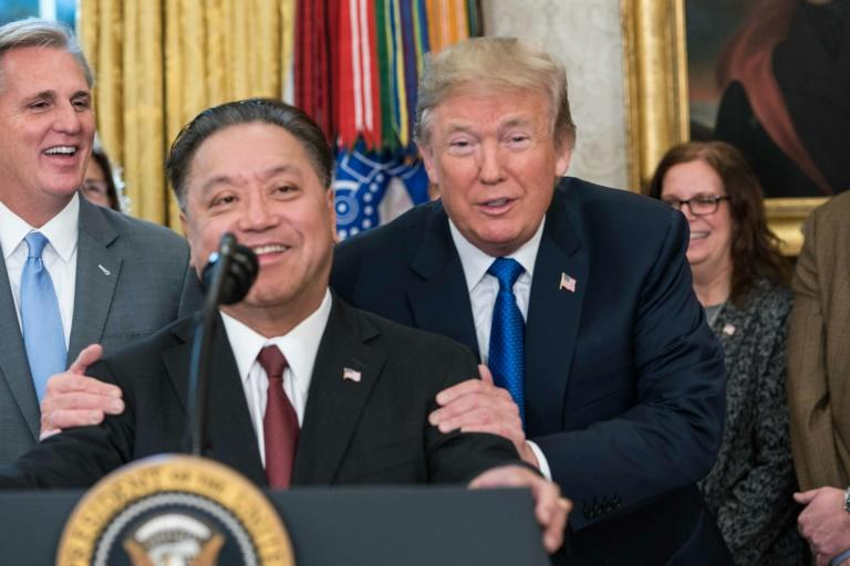 US President Donald Trump jokes in November, 2017 with Broadcom CEO Hock Tan who announced that Broadcom would be moving from Singapore back to the US, just before his firm announced a bid for US-based Qualcomm