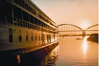 """<p>If catching a concert or indulging in movie-night with your friends (and, uh, telling the hubs he's gotta find other plans tonight) is one of your favorite at-home activities, you guys will love this charming are on the Illinois side of the Mississippi River. The town's <a href=""""http://www.riverfrontamphitheater.com/"""" rel=""""nofollow noopener"""" target=""""_blank"""" data-ylk=""""slk:Liberty Bank Amphitheater"""" class=""""link rapid-noclick-resp""""><u>Liberty Bank Amphitheater</u></a> hosts film screenings under-the-stars, the <a href=""""http://www.greatriverroad.com/vadalabene.htm"""" rel=""""nofollow noopener"""" target=""""_blank"""" data-ylk=""""slk:Sam Vadalabene bike trail"""" class=""""link rapid-noclick-resp""""><u>Sam Vadalabene bike trail</u></a> boasts fantastic rides for active types, and wildlife enthusiasts will adore the <a href=""""http://riverlands.audubon.org/"""" rel=""""nofollow noopener"""" target=""""_blank"""" data-ylk=""""slk:Audubon Center at Riverlands"""" class=""""link rapid-noclick-resp""""><u>Audubon Center at Riverlands</u></a>. There are many ways to spend your days, but perhaps the best way to spend your nights is at the rustic and chic <a href=""""https://www.heartlandlodge.com/cabins-in-illinois/heavenly-view-cabin/"""" rel=""""nofollow noopener"""" target=""""_blank"""" data-ylk=""""slk:Heavenly View Cabin"""" class=""""link rapid-noclick-resp""""><u>Heavenly View Cabin</u></a>.</p><p><strong><em>For more information, visit </em></strong><a href=""""http://www.visitalton.com/"""" rel=""""nofollow noopener"""" target=""""_blank"""" data-ylk=""""slk:visitalton.com"""" class=""""link rapid-noclick-resp""""><strong><em>visitalton.com</em></strong></a><strong><em>.</em></strong></p>"""