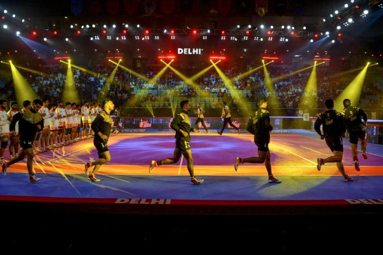 Bright lights, big rewards: Telugu Titans players arrive on the court to face Telugu Titans in the glitzy money-spinning Pro Kabaddi League at Thyagaraj Sports Complex in New Delhi