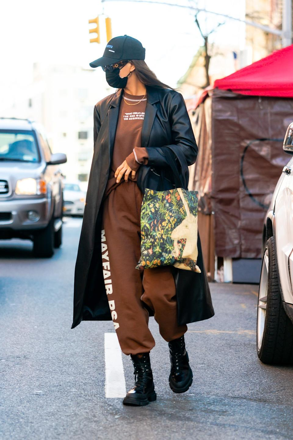 Irina Shayk styled the Mango Leather Coat with a tracksuit and chunky biker boots in New York over the weekend.  (Getty Images)