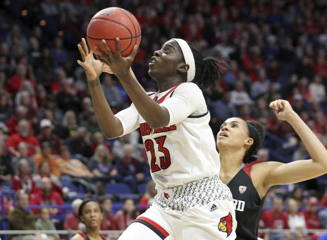 Louisville's Jazmine Jones (23) shoots near Stanford's Kaylee Johnson during the first half of an NCAA women's college basketball tournament regional semifinal Friday, March 23, 2018, in Lexington, Ky. (AP Photo/James Crisp)