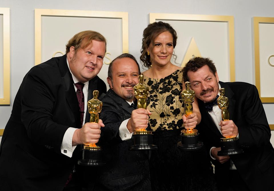 Phillip Bladh, Carlos Cortes, Michellee Couttolenc and Jaime Baksht, winners of the award for Best Sound for 'Sound of Metal'EPA