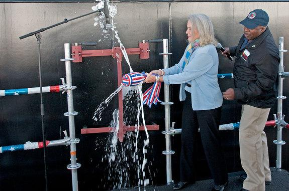 Lyn Glenn, daughter of John Glenn and the sponsor of the USNS John Glenn, christens the ship on Feb. 1, 2014 in San Diego, Calif.