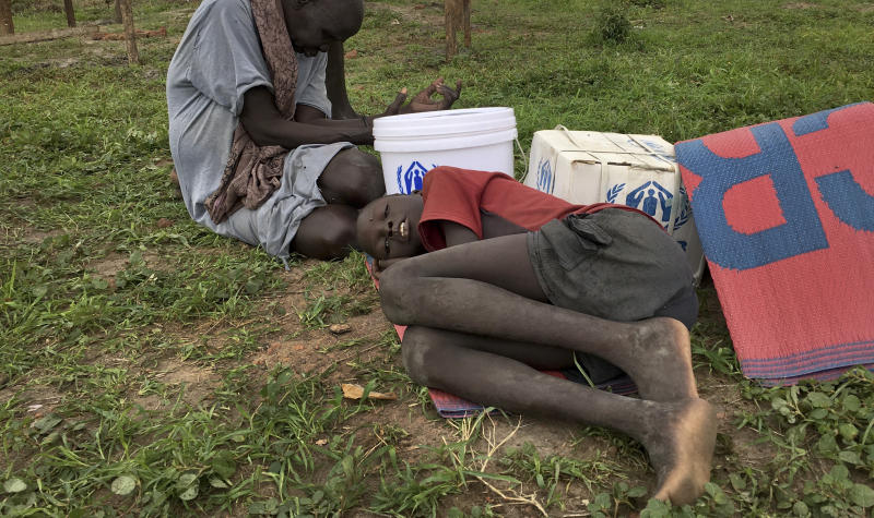 A boy rests on the grass during a visit of UNCHR High Commissioner Filippo Grandi to a new site for displaced people outside of the U.N. protected camp, in Bentiu, South Sudan Sunday, June 18, 2017. Thousands of South Sudanese now live in U.N. protected camps, including eighty percent of Bentiu's population. (AP Photo/Sam Mednick)