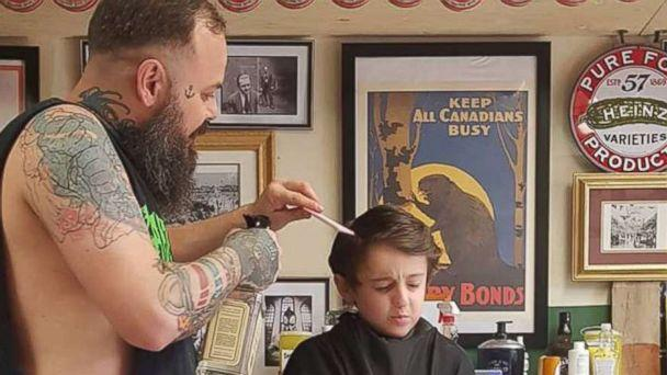 PHOTO: Franz Jakob, a barber in Rouyn-Noranda, Quebec, had to go onto the floor to cut Wyatt Lafreniere. The 6-year-old boy has autism with sensory issues. (Fauve Lafreniere)