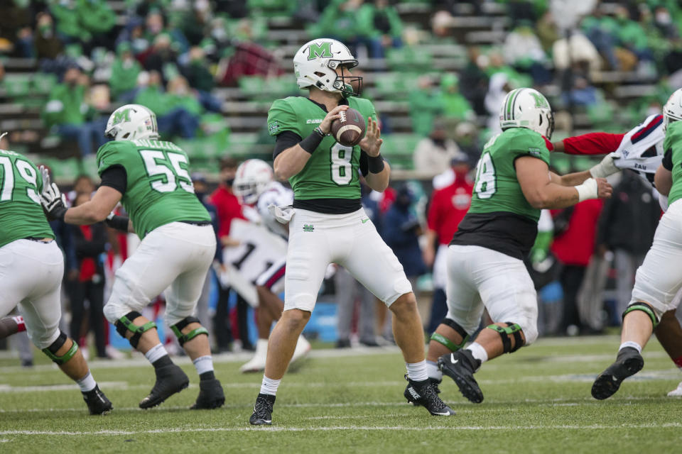 Marshall quarterback Grant Wells looks to make a throw downfield against Florida Atlantic during an NCAA college football game Saturday, Oct. 24, 2020, in Huntington, W.Va. (Sholten Singer/The Herald-Dispatch via AP)
