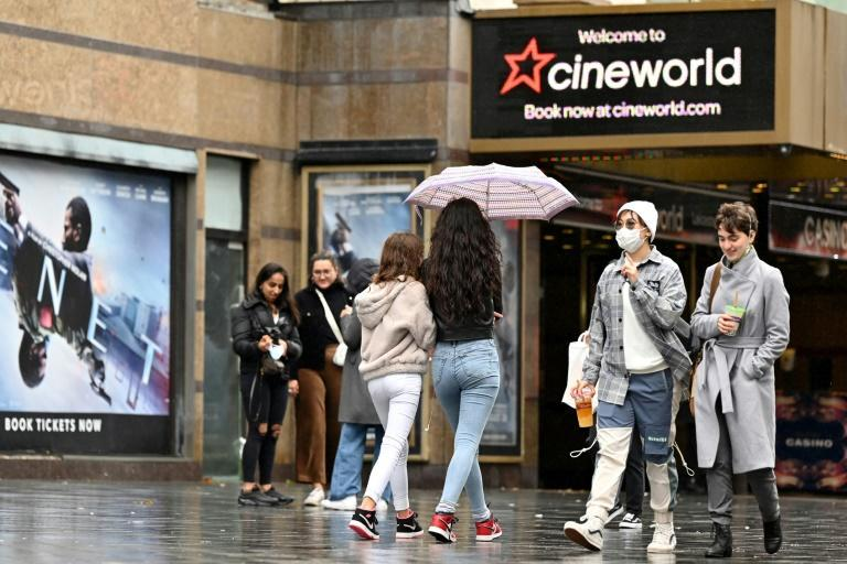 People walk past a cineworld cinema in Leicester Square, London