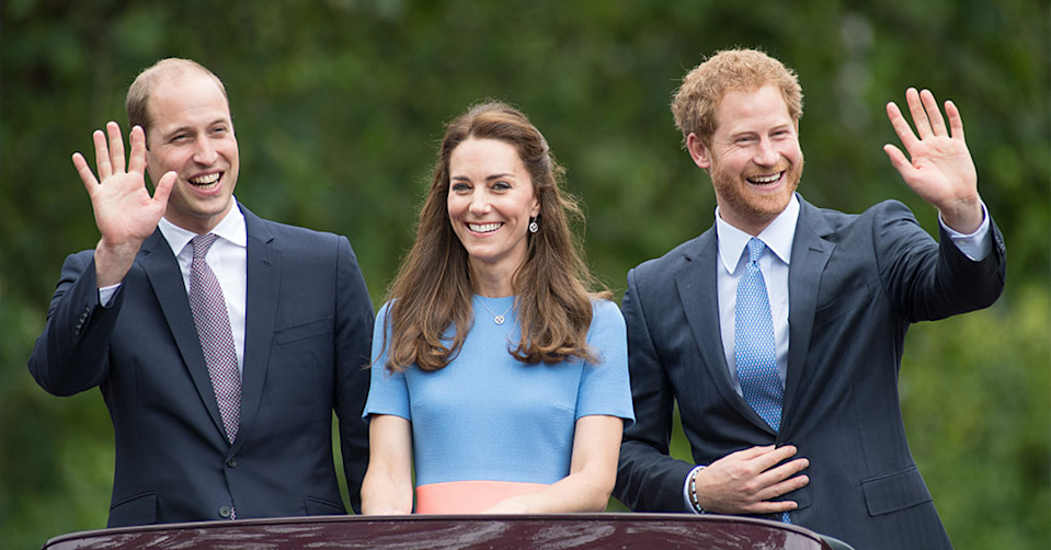Prince William, Kate Middleton and Prince Harry looking happy together.