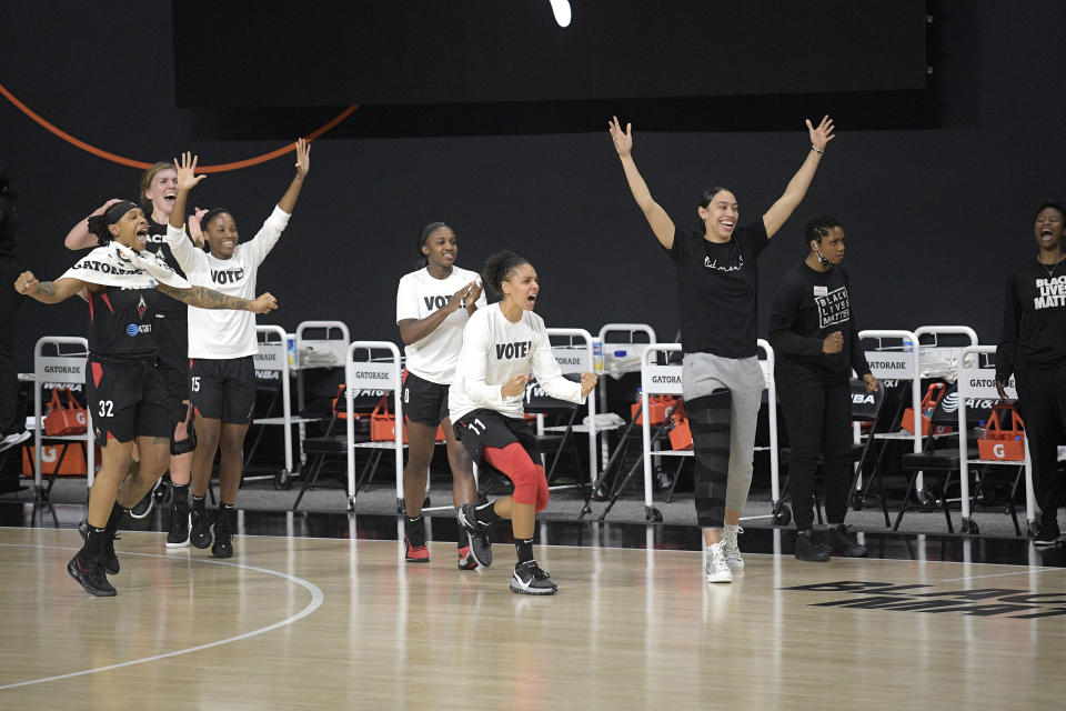 Las Vegas Aces players celebrate after Game 5 of a WNBA basketball semi-final round playoff series against the Connecticut Sun, Tuesday, Sept. 29, 2020, in Bradenton, Fla. (AP Photo/Phelan M. Ebenhack)